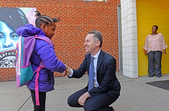 Richmond Public School Superintendent Jason Kamras greets a student at Westover Hills Elementary School in 2018.