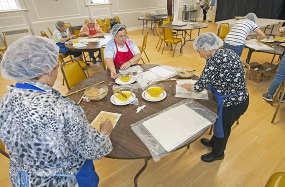 Volunteers at St. James Armenian Church spend a morning preparing bourma, a dessert similar to baklava, for the 61st annual Armenian Food Festival.