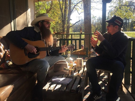"""Real life musician Ben Dickey receives instruction from director Ethan Hawke on the set of """"Blaze."""" Dickey won a special jury award for achievement in acting at the Sundance film festival last year for his role as Texas singer/songwriter Blaze Foley."""