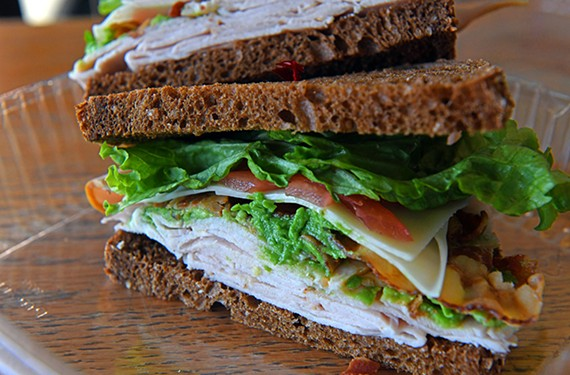 The California club at Cuisine a la Carte: smoked turkey, bacon, avocado, Swiss cheese, lettuce, tomato, dill mayo on whole wheat bread.