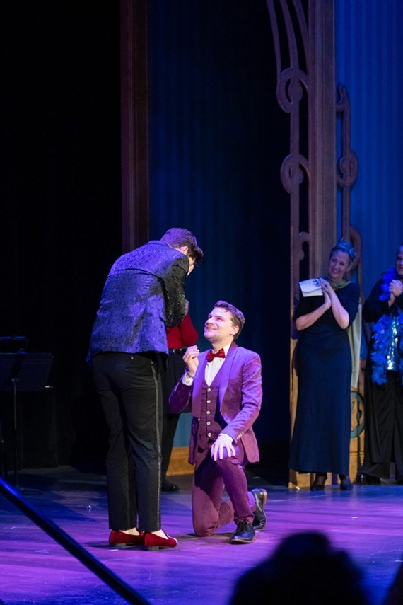 "Lucian Restivo, Richmond Triangle Players' artistic director and award-winning director of the play, ""The Laramie Project,"" proposes to boyfriend Luke Newsome from the stage."