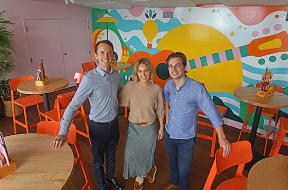 Siblings Kyle Healy, Paige Healy and Colin Healy pictured inside their family's colorful new restaurant, Island Shrimp Co.