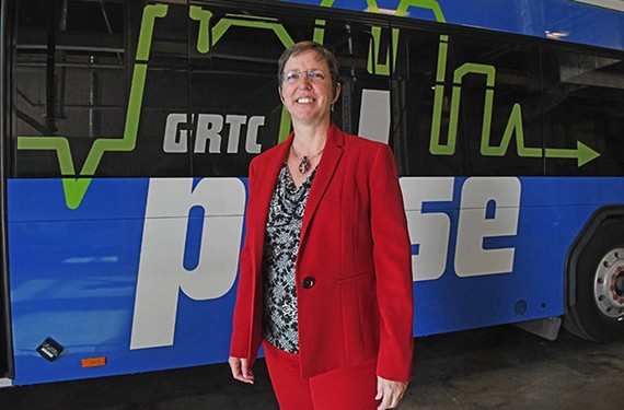 The new chief executive of GRTC, Julie Timm, stands with a Pulse bus in the maintenance area of GRTC headquarters at 301 E. Belt Blvd.