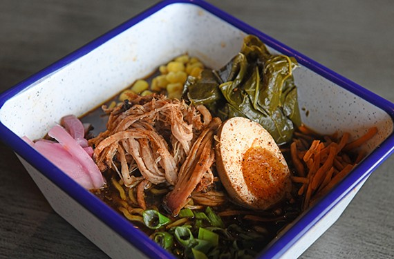 The innovative Fatty's ramen combines carrots, corn and collard greens in a smoked pork broth with pickled onions, scallions and a marinated egg.