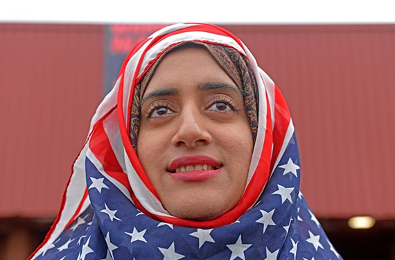 Jan. 12 — Shabina Shahnawaz joined about a thousand protesters at the Women's Rights March RVA on the Boulevard. Photographer's note: At rallies and marches, I am always looking for one person who tells the story. These events tend to be chaotic and it's easy to be overwhelmed. When I saw Shahnawaz with her American flag hijab, I knew that out of 1,000 people she was the one. Nikon D750, 24-70 mm lens.