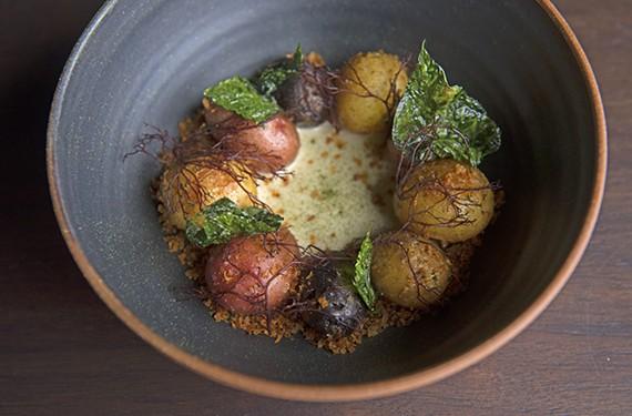 Roasted potatoes with koji cream, potato greens, seaweed and potato crumble from Longoven.