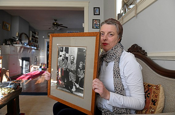 Lara Dos Passos Coggin holds a portrait of her grandfather, whose home is a national historic landmark in Westmoreland County, Virginia.