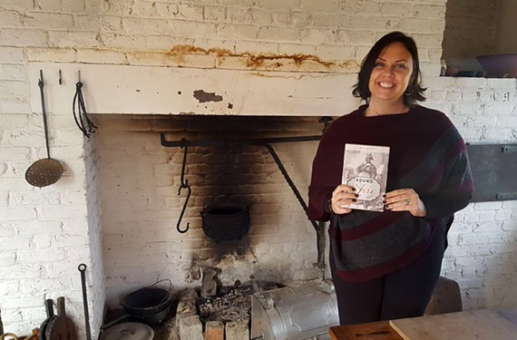 "Author Kelley Fanto Deetz holds a copy of her book ""Bound to the Fire: How Virginia's Enslaved Cooks Helped Invent American Cuisine."" She'll be speaking at the Virginia Museum of History & Culture on Feb. 27."