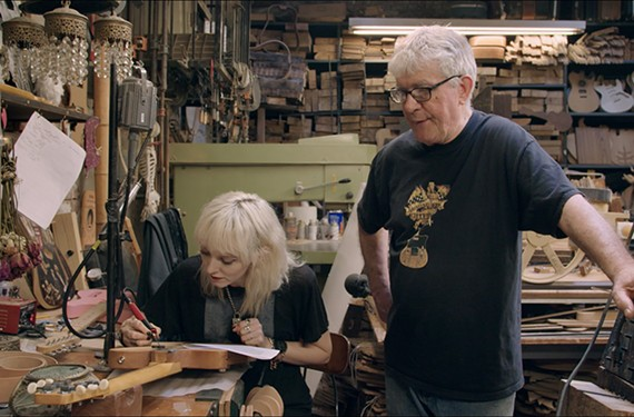 "Old school Greenwich Village guitarmaker Rick Kelly, pictured here with his apprentice, Cindy Hulej, in a scene from the Ron Mann documentary, ""Carmine Street Guitars."""
