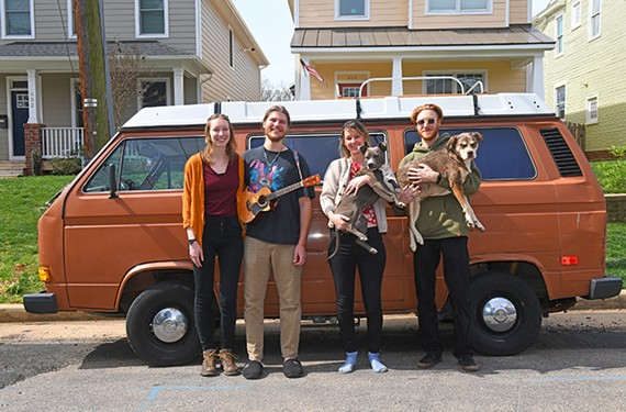 Alex Dahl, Stuart Kindle, Erin Coggins with Penelope, and Ethan Harr, holding Layla, pose in front of a 1983 Volkswagen van.