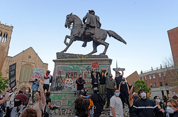 After leaving a rally at the Robert E. Lee monument, protestors swarmed the J.E.B Stuart statue on Monument Avenue on Sunday, May 31. The crowd had just left a rally at the Lee monument as the city's curfew began.