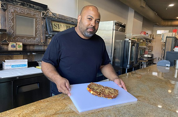 Owner Brandon Jackson, also known as Beni Barca, works on perfecting the grilled cheese at Cheddar Jackson.