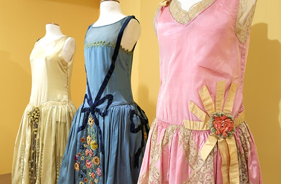 "Left: Evening dress worn by Elise Francis Wilmer, gift of Miss Elise Wilmer (Yerxa). Middle: Evening dress worn by Susan ""Sadie"" Spilberg, gift of Norma Levarie. Right: Bridesmaid dress worn by Elizabeth Bland Brockenbrough, gift of Elizabeth B. Brockenbrough."