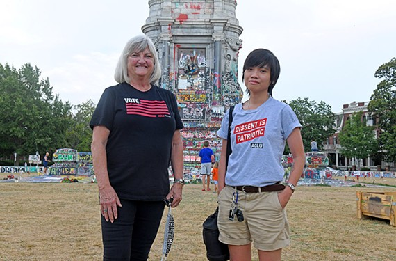 Claire Guthrie Gastañaga, executive director of the ACLU of Virginia, and Phuong Tran, digital communications manager, stand in the area rechristened by protesters as Marcus-David Peters Circle.
