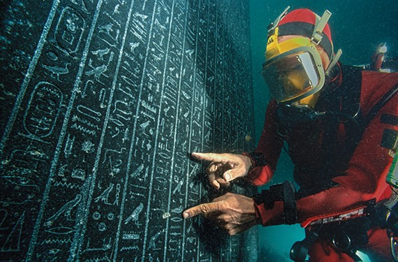 An archaeologist checks the stele of Thonis-Heracleion raised under water on site in the city of Heracleion.