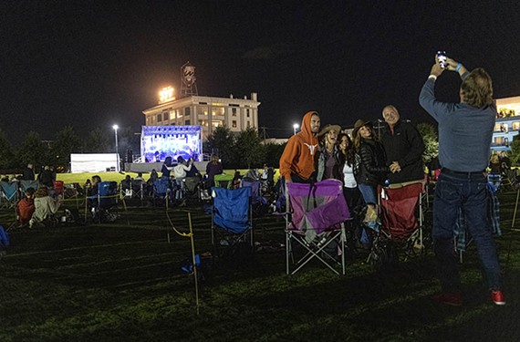 Friends pose for a photo in their socially distanced pod during a concert by Full Moon Fever, a local Tom Petty tribute group, at Bon Secours Training Center.