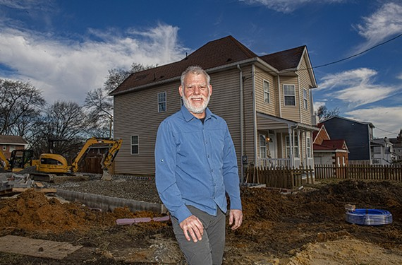 Bryan Traylor, owner of Unlimited Renovations LLC, stands in front of one of his houses on North 20th Street in Church Hill.
