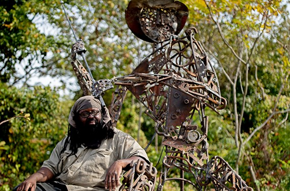 """Artist Keith Ramsey sculpted """"Edwards the Fisherman"""" out of saw blades, chains, drill presses, wrenches, nuts and bolts, rebar and other found objects."""