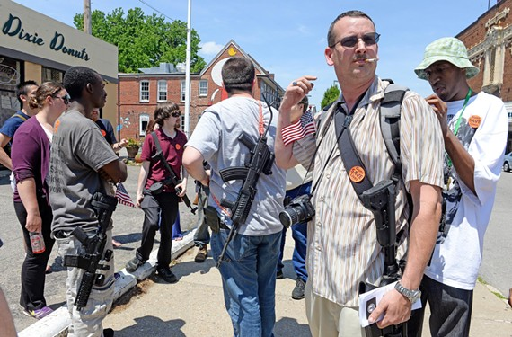 Brandon Howard and others use last month's Carytown walk to honor four fellow open-carry activists recently killed in a car accident.