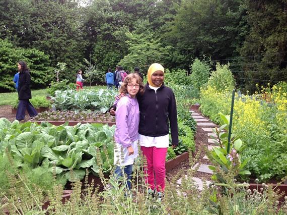 Richmonders Lilah Monroe and Amina Abdulkadir in the White House kitchen garden yesterday.