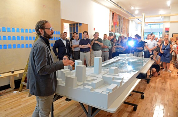 Peter Culley, an architect with Spatial Affairs, presents the plan for BridgePark, which connects downtown and Manchester. The model is on view to the public at the Storefront for Community Design.