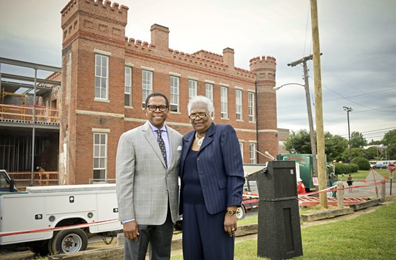 Monroe Harris, chairman of the capital campaign, and Marilyn West, the chairwoman of the museum's board of trustees, stand in front of the Leigh Street Armory.