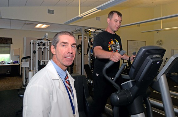 At the McGuire Veterans Affairs Medical Center in Richmond, Dr. Joseph Webster is part of a team that works with polytrauma patients from across the United States. Pictured with patient Christopher Eagal.