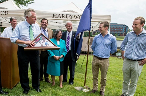 Gov. Terry McAuliffe congratulates Hardywood co-owners Eric McKay and Patrick Murtaugh last week, at the announcement of the company's plans to open a new brewing complex in Goochland.
