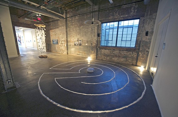 "Janelle Proulx and Dana Ollestad's ""Untitled"" (2015) is a salt and multichannel audio installation that creates a labyrinth for the viewer; in the background is artist Annie Campbell's ""Overburden"" (2015), a sparkling, hanging resin sculpture."