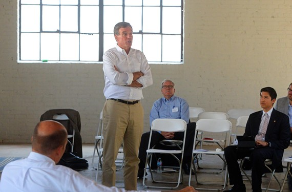 During a visit in Richmond Friday, U.S. Sen. Mark Warner discusses the economy with entrepreneurs and investors.