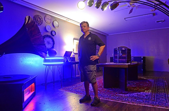 Founder Josh Czarda stands in the steam-punk-themed space at Escape Room RVA in the Village Shopping Center.