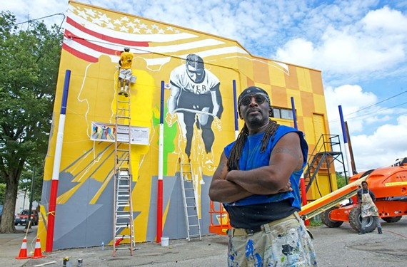 "Artist James Thornhill's new Jackson Ward mural depicts world champion bicycle racer Marshall ""Major"" Taylor."