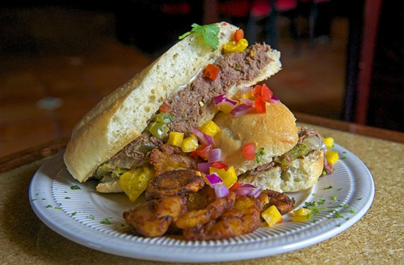 The sloppy José — tender shredded beef with swiss cheese — is  a must-try at Kuba Kuba Dos.