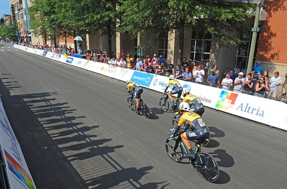 Cyclists race past the Greater Richmond Center during Sunday's Elite Men's Time Trial. But some restaurants say sales aren't moving so fast.