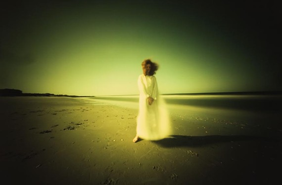 "Photographer Willie Anne Wright's ""Pawley's Island, South Carolina: Nancy by the  Ocean,"" a cibachrome pinhole photograph. Candela Books and Gallery will be releasing 42 of her images in its sixth book release."