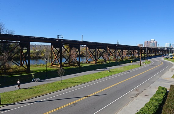 Trail followers can see the city near the train trestle along Dock Street beside the Canal Walk.