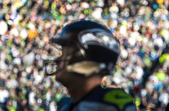 "Robin Layton photographed this Seattle Seahawk player artistically for the book ""12."""