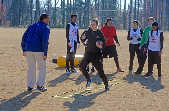 "Coach Brian ""Bleep"" West leads members of the Black Widow women's football team through agility exercises during practice Saturday morning. They hope to play their first game in April."