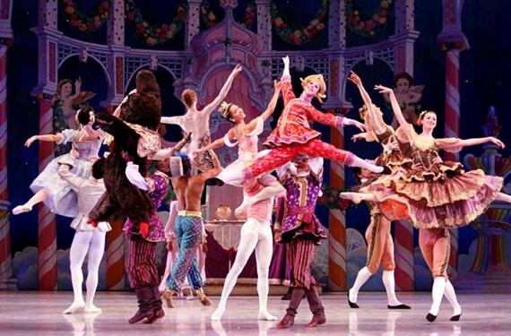"Richmond Ballet dancer Maggie Small is held aloft among cast members of ""The Nutcracker."""