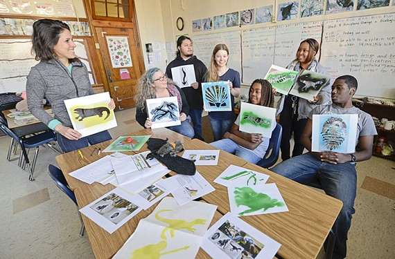 The director of Groundwork RVA, Giles Harnsberger, Summer Schultz , Jose Diaz, Ashley Dewitt, Shiloh Paul, Tyasha Casey and Mikaili Lee hold up their environmentally conscious art.