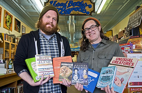 Chop Suey Books owner Ward Tefft (right), and employee Andrew Blossom.