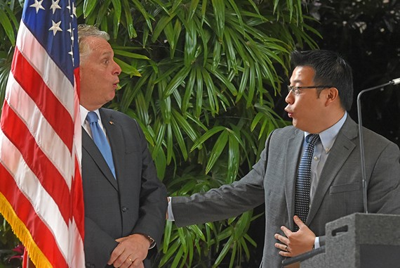 Gov. Terry McAuliffe and Tom Lin, AvePoint corporate vice president of North American sales, share a laugh at the news conference Jan. 29 while announcing the company's expansion into Richmond.