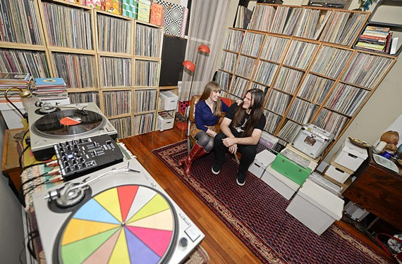 Greg Darden and Sara Gossett sit at home surrounded by their impressive collection of vinyl; both are musicians and perform as DJs around town.