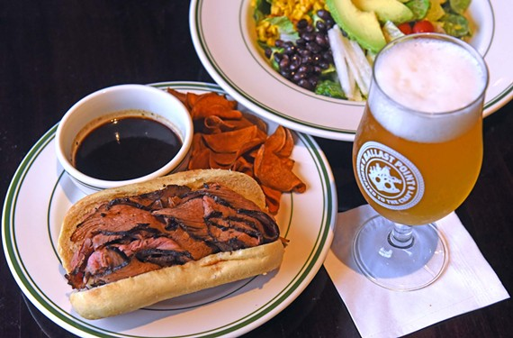 Tri-tip is a cut of beef beloved on the West Coast. Here, it's given the French dip treatment and served with a glass of San Diego's Ballast Point Wahoo White.