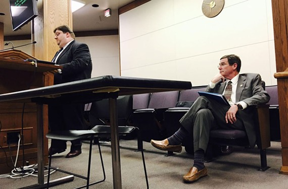 Virginian-Pilot reporter Gary Harki speaks before the Virginia House FOIA subcommittee regarding his opposition to SB552 sponsored by Sen. John Cosgrove, right, of Chesapeake, in Hall C of the General Assembly building in Richmond, Va. Thursday, Feb. 25, 2016. The subcommittee stopped the bill.