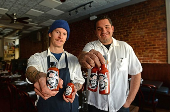 Heritage's sous chef Mike Hill and chef and owner Joe Sparatta make their own hot sauce called Texas Mike's, on tables at brunch and for sale at the restaurant.