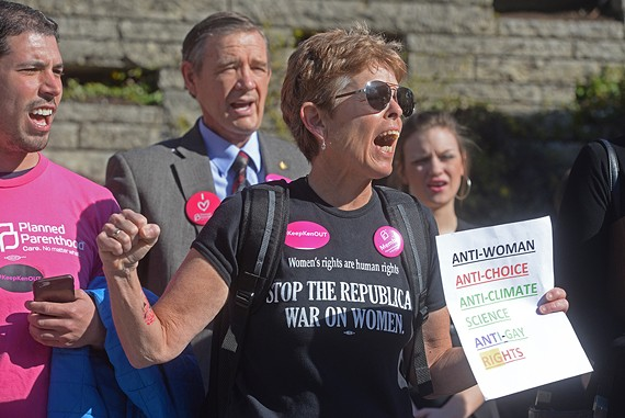 Margaret Doyle of Richmond voices her opposition to Cuccinelli's nomination during a demonstrantion this morning at the State Capitol.