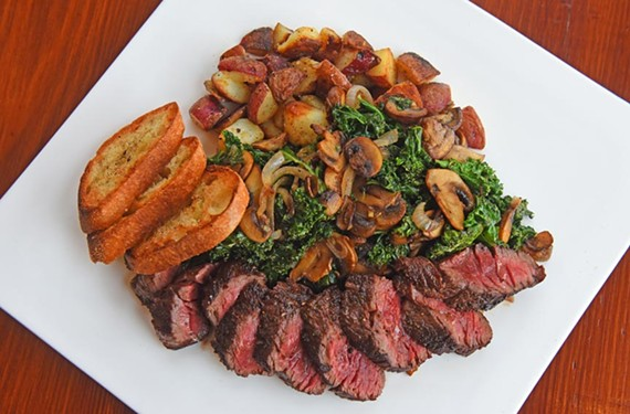Pop's Market on Grace brings breakfast, lunch and dinner to downtown — here, hanger steak rests next to a bed of kale and is accompanied by roasted red potatoes and mushrooms.