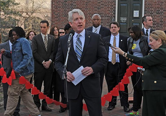 Mark Herring speaks at a vigil to honor gun violence victims at the Capitol Bell Tower in 2015.