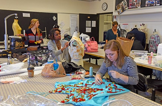 VCU fashion students Emily Rouse and Toni Johnson, professor Holly Alford and student Shelby Rider work on creations for the department's popular show in May.